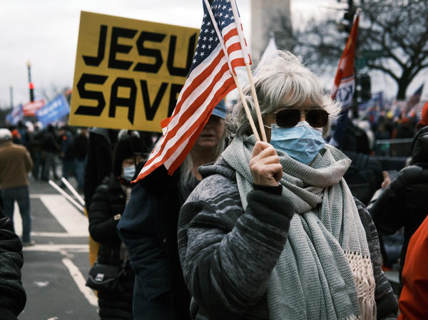 """JESUS SAVES"" banners were among those carried during a rally on Jan. 6, 2021, in Washington before rioters stormed the Capitol."
