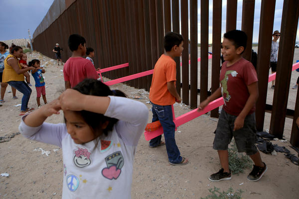 American and Mexican families play with a seesaw installation at the border near Ciudad Juarez, Mexico, in July 2019. London's Design Museum recognized the project with an award for best design of 2020.
