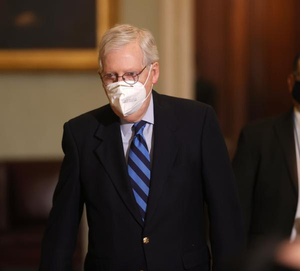 Senate Majority Leader Mitch McConnell leaves the Senate chamber on Tuesday. In remarks, he publicly denounced President Trump for instigating the Jan. 6 insurrection on the Capitol.