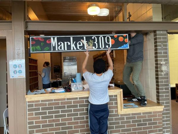 Signage for Market 309 is hung at the Logan Recreation Center in South Peoria ahead of Sunday's grand opening.