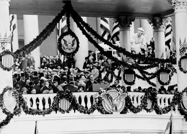President Franklin D. Roosevelt makes his inaugural address to an audience before the East Portico of the Capitol in 1933.