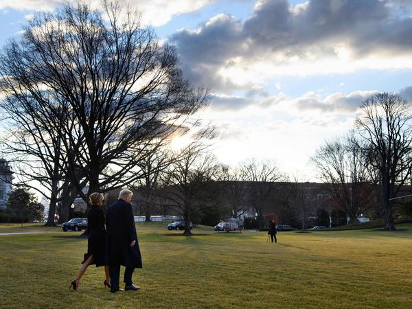 President Trump and first lady Melania Trump make their way to board Marine One as they depart the White House for the last time.