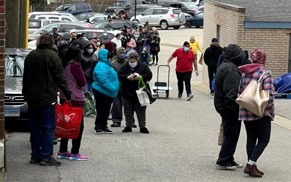 New London, Connecticut, residents lining up at food distribution center.