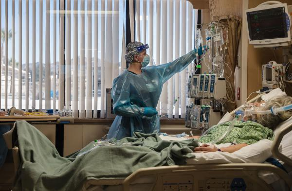 A nurse tends to a Covid-19 patient in the intensive care unit at Providence St. Mary Medical Center in Apple Valley, Calif., on Jan. 11.