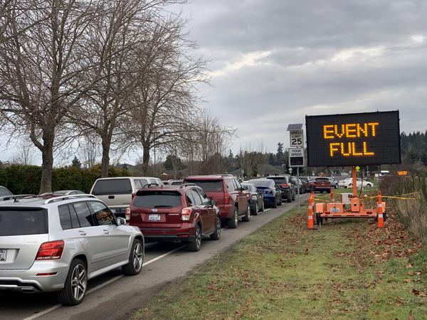 File photo. Eager seniors filled up all of the first come, first serve slots at a drive-thru COVID vaccination clinic before the first shots were even given on Thursday, Jan. 14, 2021, in Sequim, Washington.