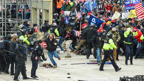 Trump supporters clash with police and security forces as they storm the U.S. Capitol on Jan. 6.