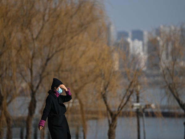 A woman walks in a park along Yangtze River in Wuhan on Jan. 19, 2021. Residents of the city of 11 million, which was the first epicenter of COVID-19, have conflicting emotions as they reckon with the aftermath of the virus and their 76-day lockdown.