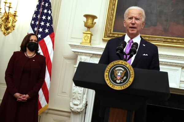 U.S. President Joe Biden speaks as Vice President Kamala Harris looks on during an event at the State Dining Room of the White House in Washington, DC.