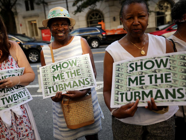 Supporters rally outside the U.S. Treasury Department in 2019 to demand that American abolitionist Harriet Tubman's image be put on the $20 bill.