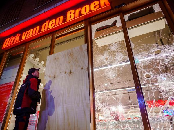 Protesters threw fireworks and rocks at police, damaged storefronts and looted stores during demonstrations on Monday in the Netherlands.