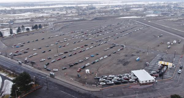 Hundreds of cars lined up for the opening day of a mass vaccination event in Washington's Tri-Cities on Monday, Jan. 25, 2021, at the Benton County Fairgrounds.