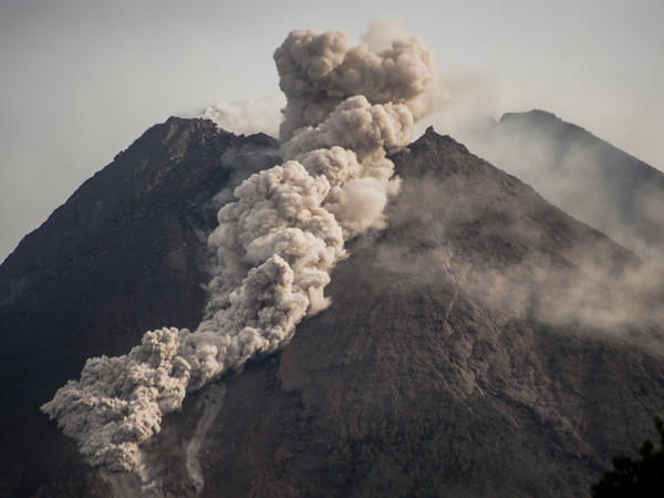 Mount Merapi, Indonesia's most active volcano, spews rocks and gas into Wednesday's morning sky.