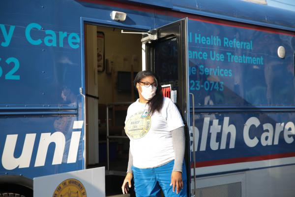 Stacy Fields, a registered nurse with Yale New Haven Health and health chair at the Greater New Haven NAACP, talks to people in the community about getting a flu vaccine through Yale's School of Medicine's Community Health Care Van, Fri., Dec. 11, 2020.