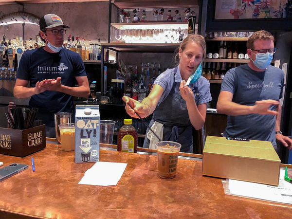 Lauren Moran, a pastry chef who owns a bakery and café, taste-tests Cornwall's new coffee drinks with her husband, Cornwall's general manager Billy Moran (left), and Speedwell Coffee Co. owner Derek Anderson.
