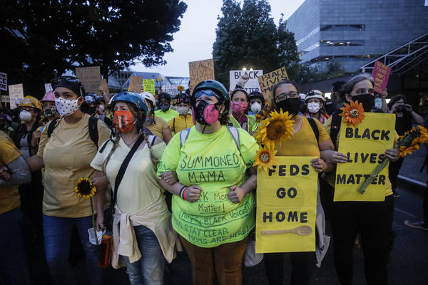 """Members of the """"Wall of Moms"""" march during a Black Lives Matter protest at the Mark O. Hatfield United States Courthouse last week in Portland, Ore."""