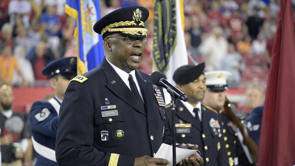 Gen. Lloyd Austin addresses military recruits during an induction ceremony in Tampa, Fla., in 2015.