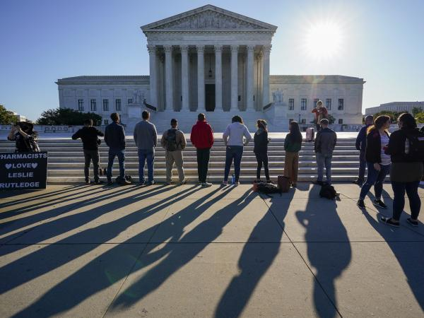 Anti-abortion rights activists demonstrate at the Supreme Court in Washington on Oct. 5. The court's new conservative supermajority puts the fate of <em>Roe v. Wade</em> in doubt.