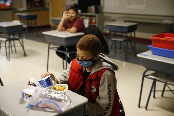 A fourth-grader eats breakfast at Mary L. Fonseca Elementary School in Fall River, Mass.