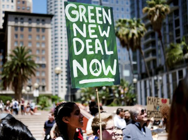 "Climate change activists holding signs join in on a rally supporting the ""Green New Deal"" in Pershing Square in downtown Los Angeles on Friday, May 24, 2019."
