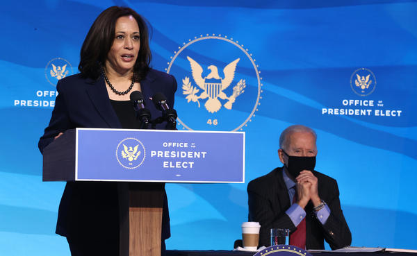 Vice President-elect Kamala Harris delivers remarks on Jan. 8 as President-elect Joe Biden looks on. The two are set to be inaugurated Wednesday at the U.S. Capitol.