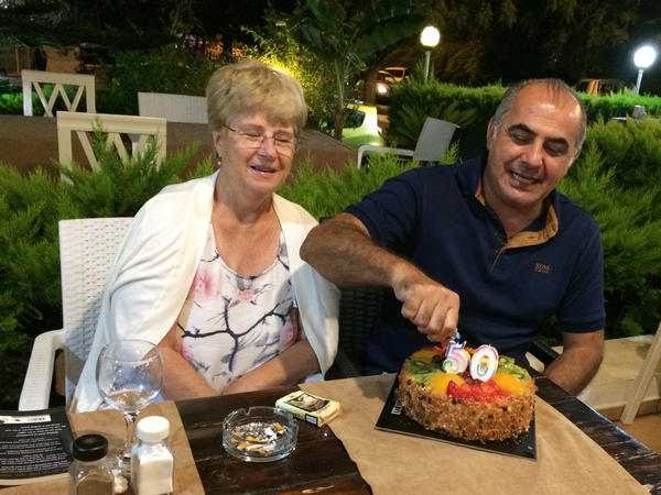 Pamela and Afshin Raghebi celebrate a birthday together. Afshin, who was born in Iran, has been stuck overseas, away from his U.S. citizen wife, for more than two years after he flew abroad for an interview at a U.S. Consulate as part of his green card application.