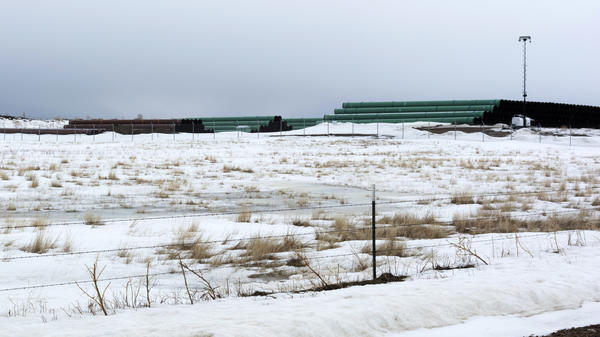 This March 11, 2020 photo provided by the Bureau of Land Management shows a storage yard north of Saco, Mont., for pipe used in construction of the Keystone XL oil pipeline near the U.S.-Canada border.