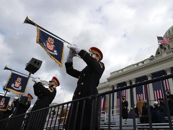 "The U.S. Army Band plays ""Pershing's Own"" during the inauguration Wednesday. World leaders, former officials and citizens voiced optimism with the arrival of a new U.S. administration."