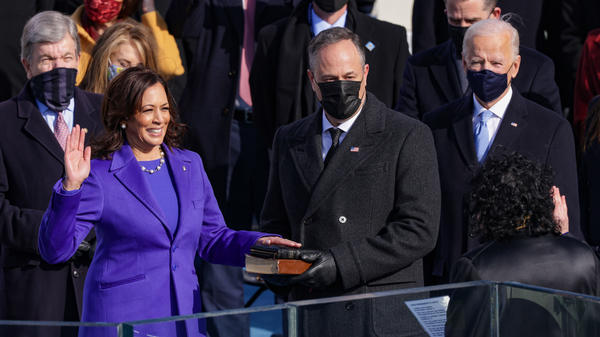 Kamala Harris is sworn as vice president by U.S. Supreme Court Associate Justice Sonia Sotomayor as her husband Doug Emhoff looks on.