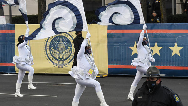 Members of Howard University's marching band walk the abbreviated parade route following the inauguration of President Biden on Jan. 20 in Washington, D.C.