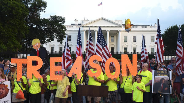 Members of Virginia's Herndon-Reston Indivisible group protest in front of the White House on Aug. 6, 2018. With Donald Trump out of office, progressive groups are turning their focus.