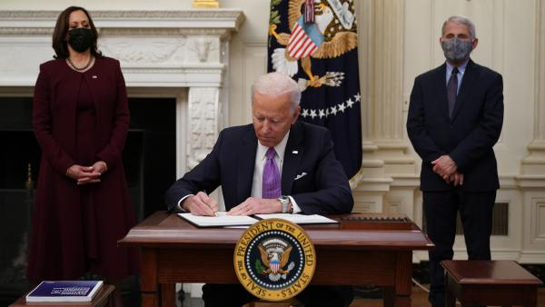 President Biden, joined by Vice President Harris and Dr. Anthony Fauci, signs executive actions as part of his administration's COVID-19 response on Thursday.