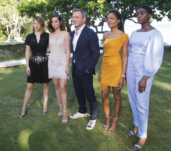 The cast of <em>No Time to Die — </em>Léa Seydoux (from left), Ana de Armas, Daniel Craig, Naomie Harris and Lashana Lynch — on location in Oracabessa, Jamaica, in 2019. The film's theatrical release is now set for Oct. 8.
