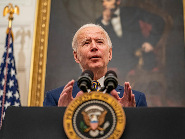 President Biden speaks on his administration's response to the economic crisis in the State Dining Room of the White House on Friday.