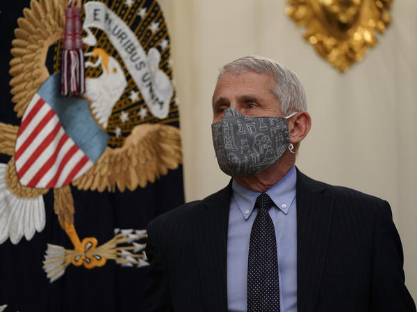 Dr. Anthony Fauci, director of the National Institute of Allergy and Infectious Diseases, arrives for an event on the coronavirus with President Biden at the White House on Thursday.