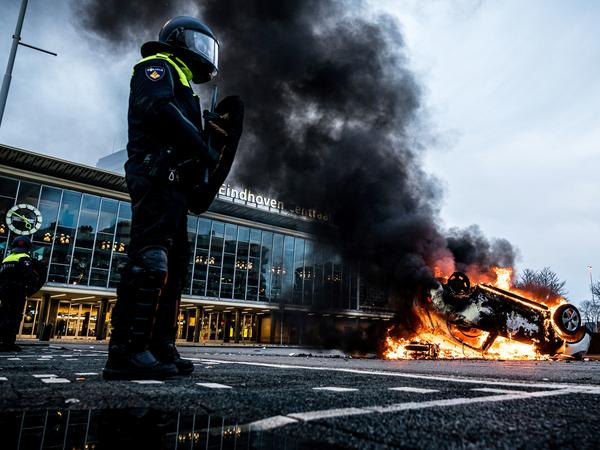 Protesters of new lockdown measures in the Netherlands burned cars and coronavirus testing sites and fought with police.