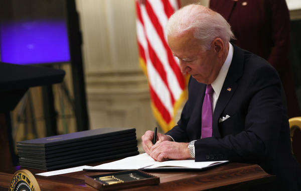 President Biden signs an executive order Thursday at the White House.