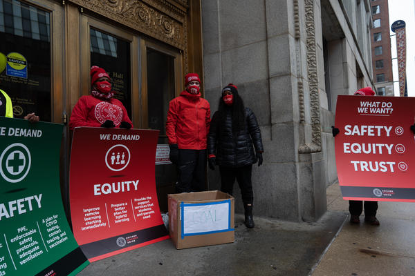 Chicago Teachers Union leaders appear outside City Hall with a list of their demands and a box of coal in December. As of Tuesday, the union has failed to reach an agreement with Chicago Public Schools on a return to in-person learning.