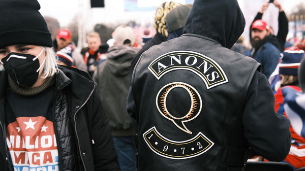 """A QAnon supporter attends the Jan. 6 """"Stop the Steal"""" rally in Washington, D.C., after which supporters of President Donald Trump stormed the U.S. Capitol."""