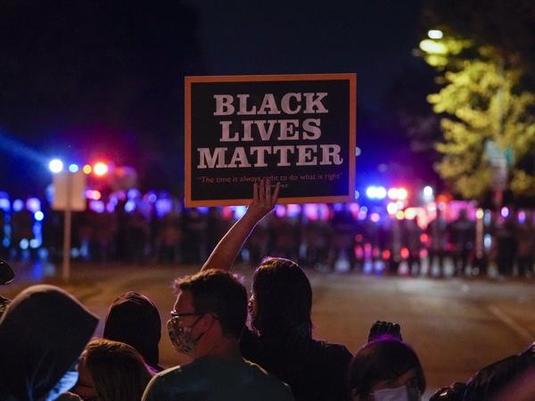Protesters and police face off in Wauwatosa, Wis., in October, after the district attorney refused to charge Officer Joseph Mensah in the shooting death of Alvin Cole early last year.