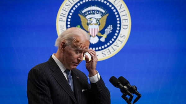 President Biden pauses while speaking after signing an executive order related to manufacturing, at the White House on Monday. Biden is off to a fast start but is running into resistance in Congress.