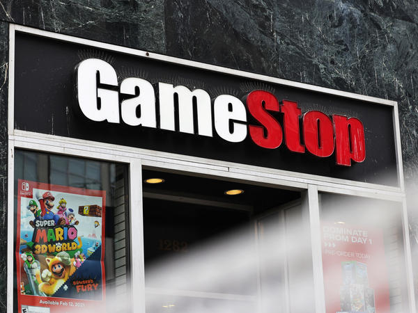 Shares of video game retailer GameStop shot up, the online broker Robinhood struggled for cash and securities regulators issued a stern warning for anyone trying to game the market.