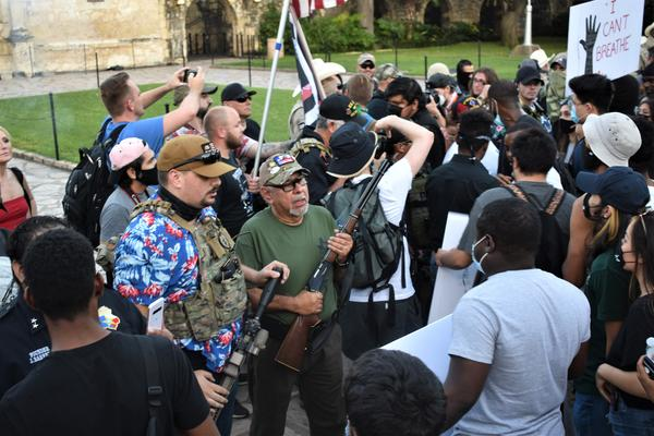 This Is Texas Freedom Force members and supporters stand in front of Black Lives Matters protestors on May 30 in front of the Alamo.