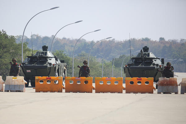 Troops block the road near parliament in Naypyitaw, capital of Myanmar. Myanmar's military announced Monday that it has seized power and will rule the country for at least one year after detaining its top political leaders.