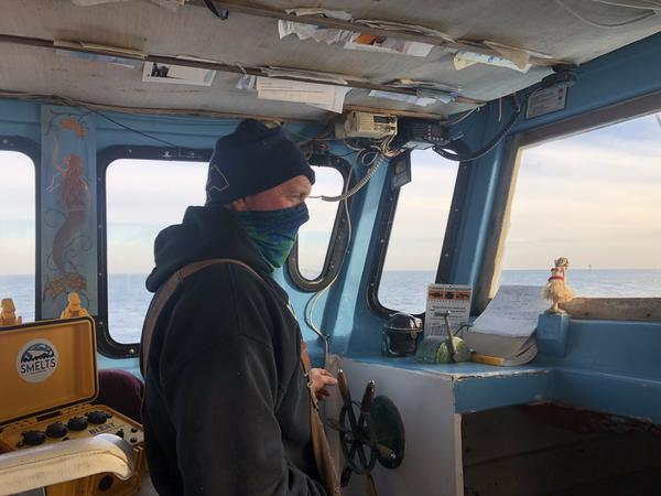 Rob Martin, 56, fishes off his boat, the Resolve, in Cape Cod Bay.