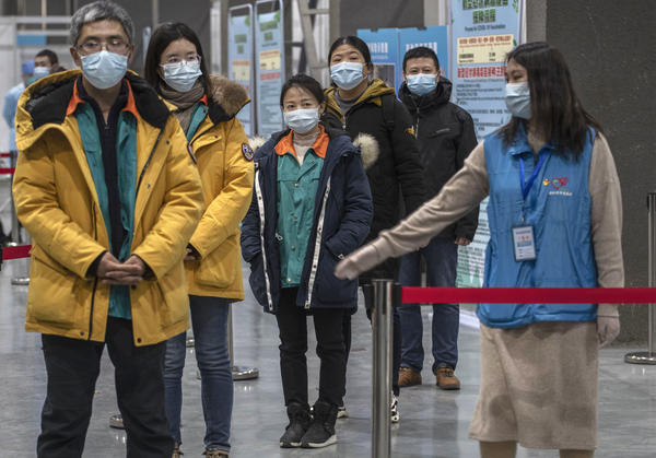 Chinese workers wait to receive a COVID-19 vaccine jab at a mass vaccination center in Beijing on Jan. 5. Even with at least 5 homegrown vaccines nearing approval, China is setting a modest initial goal: 50 million people vaccinated by mid-February — about 3.5% of the total population.