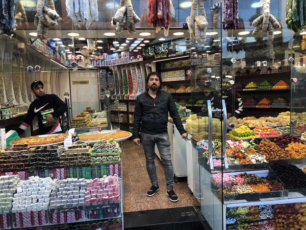 """""""Now, because of the rise of the dollar and the pensions people aren't receiving, there are two classes of people,"""" says Saad Salman, the owner of a Baghdad sweet shop. """"A poor class and a rich class."""""""