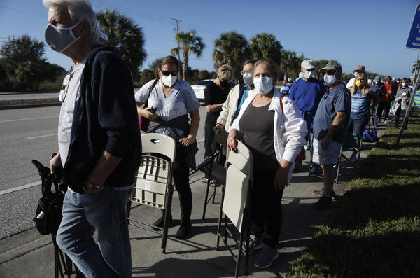 Seniors and first responders try to snag one of 800 doses available at a vaccination site in Fort Myers, Fla.