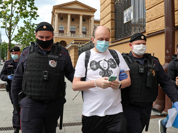 """Sergei Smirnov, pictured being detained at a """"solo protest"""" in May 2020, was sentenced to 25 days in jail on Wednesday for allegedly calling on people to protest through a Twitter repost."""