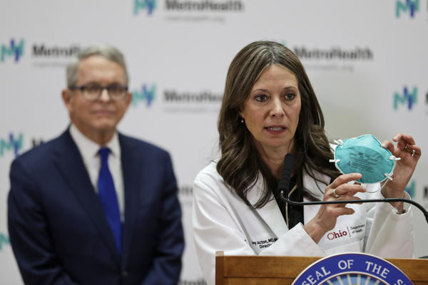 Then-Ohio Department of Health Director Amy Acton holds up a mask as she gives an update about the state's response to coronavirus, on Feb. 27, 2020 in Cleveland.