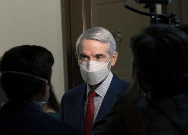 In this Jan. 19, 2021 file photo, Sen. Rob Portman, R-Ohio, speaks to members of the media outside a Senate Finance Committee hearing on Capitol Hill in Washington.